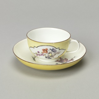 Cup and Saucer with Yellow Ground and Flowers Cup And Saucer