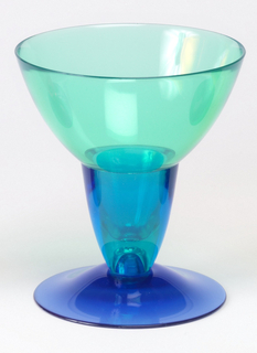 Turquoise and blue tapered drinking glass with wide mouth and dark blue foot.