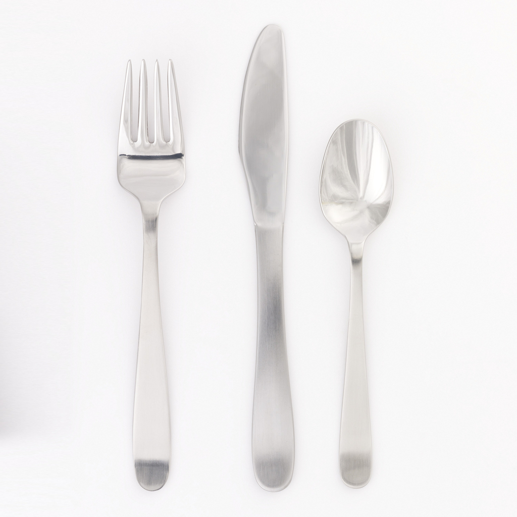 Four-pronged fork of simple form with curving tapering outline and matt surface.