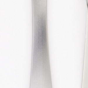 Spoon of simple form with curving tapering outline and matt surface.