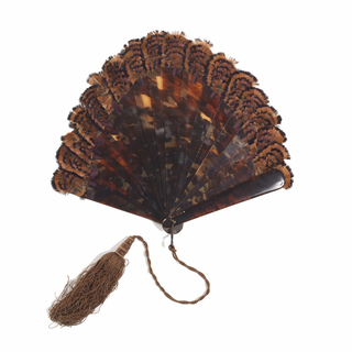 Brisé fan with tortoise shell sticks, guinea fowl feathers and silk tassel.