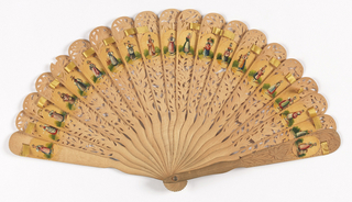 Brisé fan, carved à jour with floral forms. Each stick has an oval near its tip with a woman dressed in a costume representing the different regions of the country. The medallions are painted and varnished.