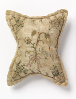 Pin cushion of cream colored silk satin embroidered with silk showing design of thorny flowers bound with ribbon.