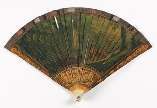 Brisé fan. Ivory sticks painted to resemble vernis martin. Obverse: a classical scene of warriors and women at camp. Reverse: a port scene. Rivet is set with a ruby-colored faceted stone. Mother-of-pearl on guards.