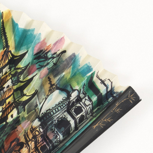 Pleated fan with a printed paper leaf with a capriccio (composite landscape) of sites in China. Wood sticks painted black. Incised wood guard.