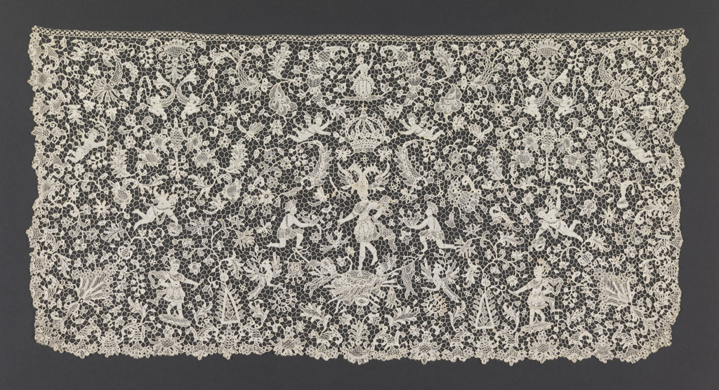 Needle lace cravat end with a delicate all-over floral design and figures, including a figure dressed as a warrior, wearing a helmet in form of a double-headed eagle, standing on a trophée flanked by kneeling warriors; the scene surmounted by a royal crown and surrounded by dolphins, winged putti, warrior figures and foliated sprays.