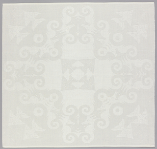 Square linen damask napkin with a cross-shaped pattern with sting rays in the center, interlocking dark and light seahorses forming the largest part of the design, and three interlocking fish in each corner.