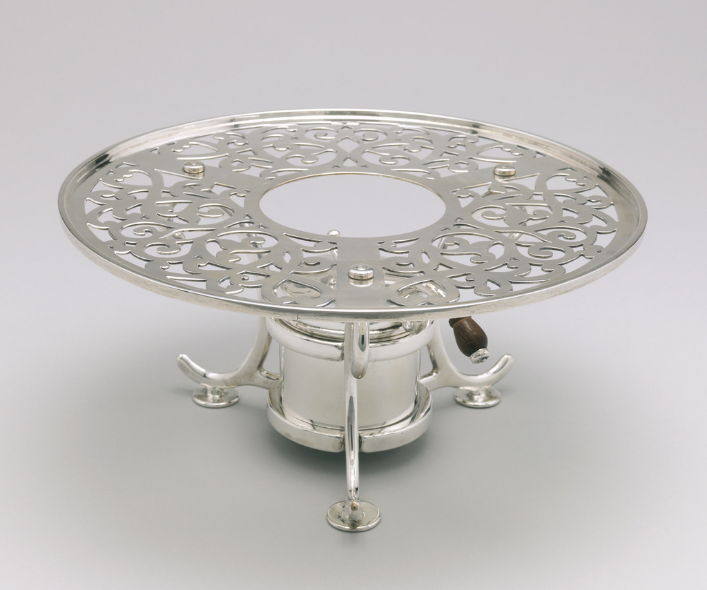 Silver circular chafing dish with tall wooden finial and long handle in wood. Composed of pan, lid, stand, Sterno pot, and lid for Sterno pot.