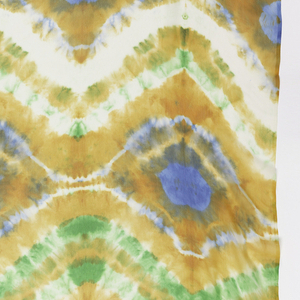 Length of silk chiffon tie-dyed in green, orange, blue, and white.