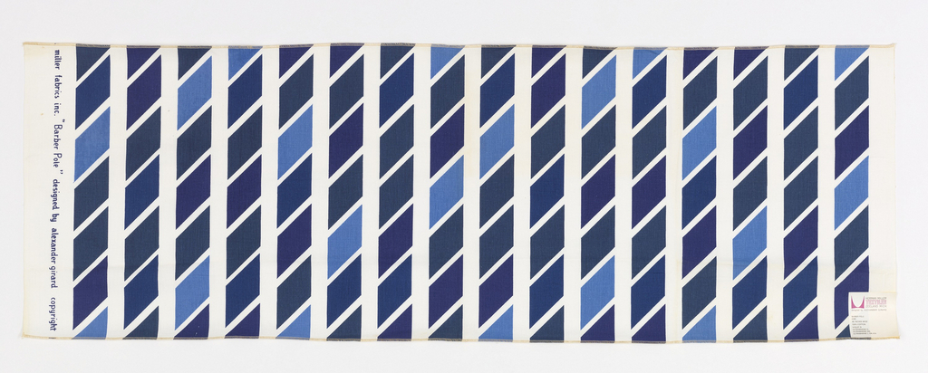 Vertical columns of regular parallelograms, printed in 4 shades of blue on white ground fabric. Both selvedges present. Both ends cut and serged.