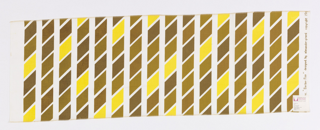 Vertical columns of regular parallelograms printed in 4 shades of yellow/brown on white ground. Two selvedges, both ends cut and serged.