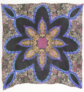 Large square scarf with rolled hem on all sides. Symmetrical design of a starburst in bright pink, orange, blue and black.