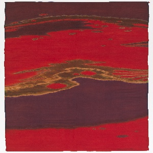 Dyed silk hanging with an abstract design, the shapes of which were defined by running stitches pulled tightly to gather the fabric and isolate areas to be dyed. In purple and brilliant red, with touches of green and yellow.