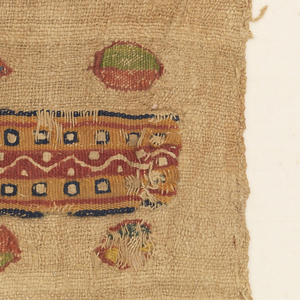 Woven linen textile showing five small inwoven polychrome tapestry ovals on either side of a narrow tapestry woven band, appliquéd to the foundation fabric. The ovals are each rimmed in red. The band has a red center with undyed angular serpentine and dots; each side is yellow and contains a row of undyed squares rimmed in blue. Narrow red and blue borders complete the band.
