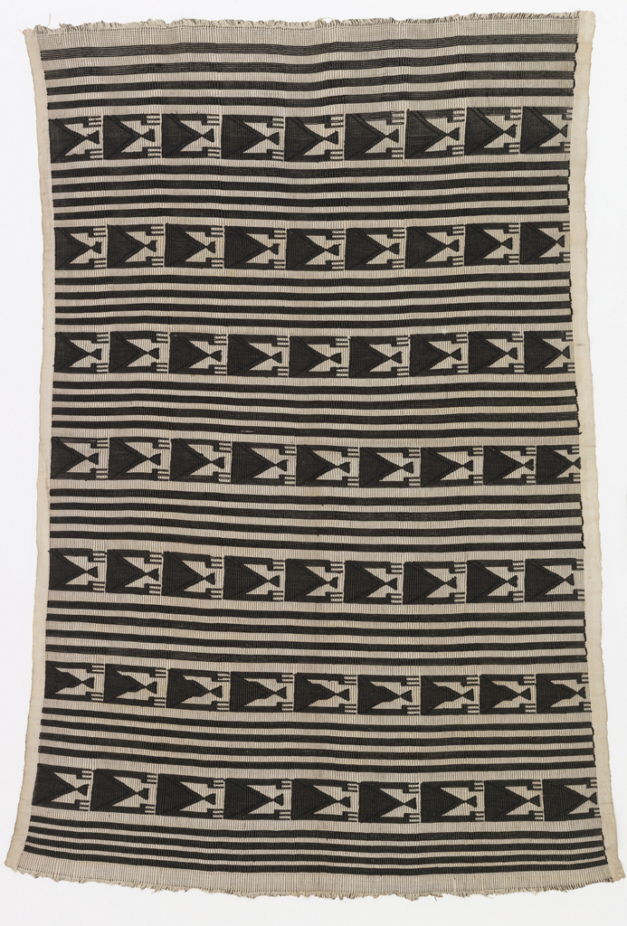 Wrapper with bands of geometric pattern separated by four black stripes on a white ground. Pattern is a repeating figure of a triangle with three-pronged appendages. 