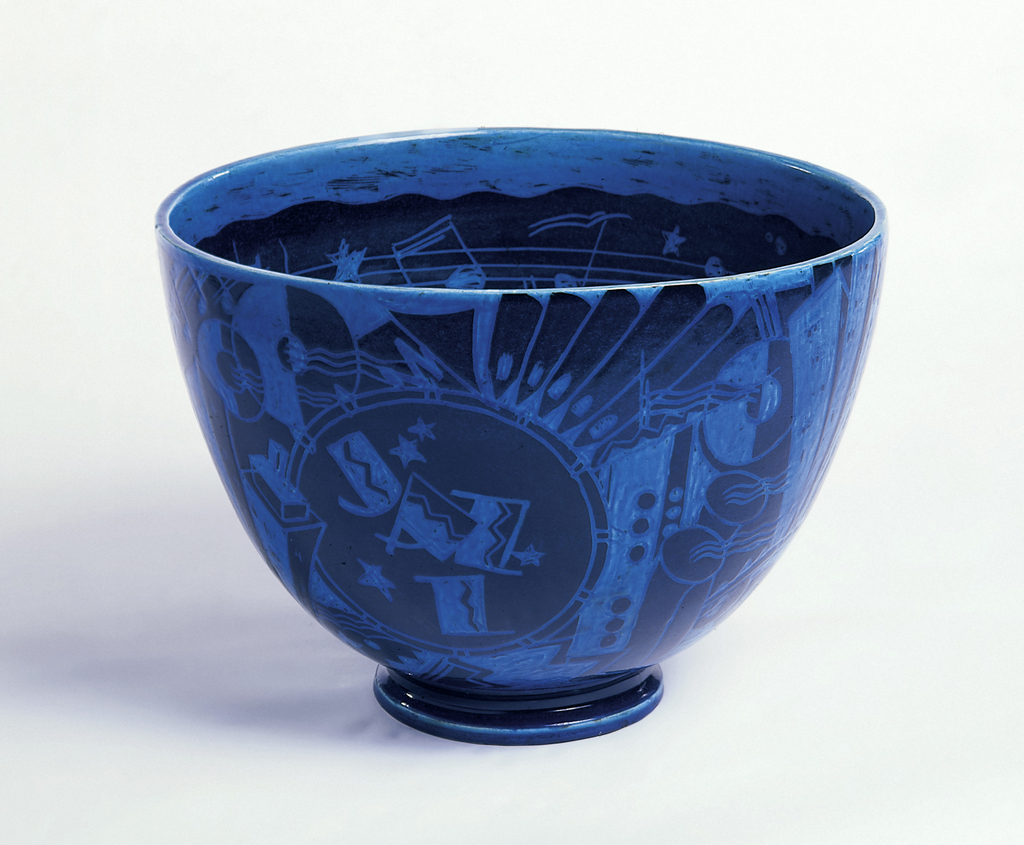 Wide-mouthed slightly bulbous circular bowl, tapering to molded circular foot. Exterior of bowl decorated with composition of sgraffito designs of stylized and geometric architecture, advertising signs, cocktail glasses, musical instruments, and figures. Designs scratched through black slip over white body, with bright turquoise transparent glaze overall. Interior of bowl decorated with continuous band of musical staff and notations. Blue glaze continues on interior.