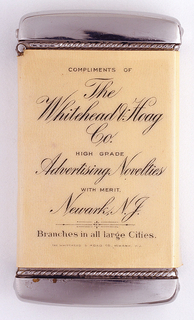"Rectangular, with rounded corners, upper and bottom edges slightly curved, featuring printed advertisement in black typeface on off-white background: ""Compliments of The Whitehead & Hoag Co., High Grade Advertising Novelties with Merit. Newark, N.J., Branches in all large Cities."" ""Whitehead & Hoag Co.,Newark, N.J."" in very fine print below. Reverse features color illustration of nude male with bird-like wings and diaphanous red fabric draped across his body; he embraces nude female with small blue, fairy-like wings. Lid hinged on side. Striker in recessed groove on bottom."