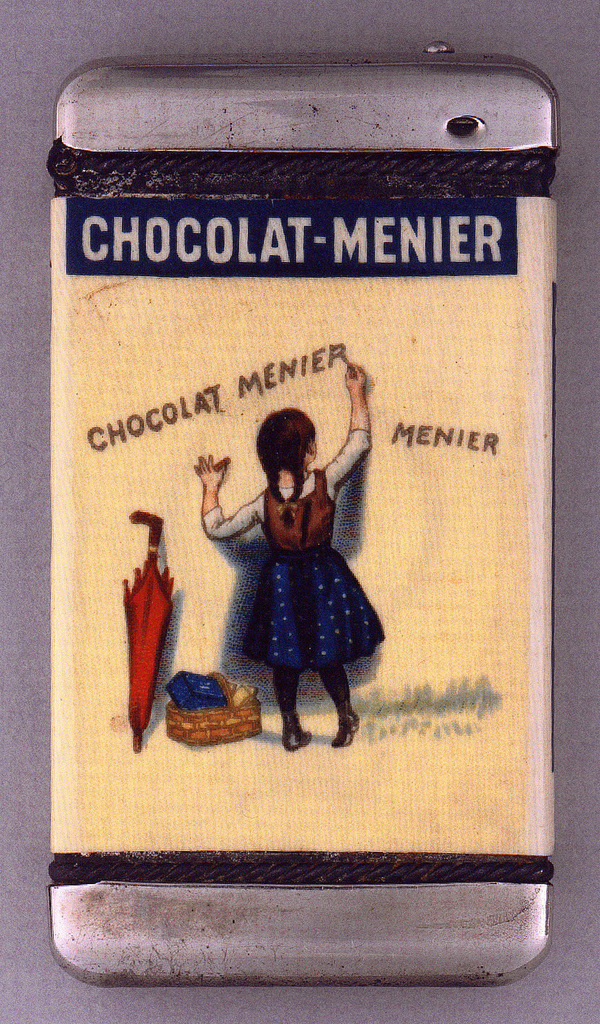 """A rectangle matchsafe with rounded corners. The front has cream colored rectangle area, depicting a young girl in a dress with an umbrella and basket stopped to write """"Chocolat- Menier"""" on the wall."""