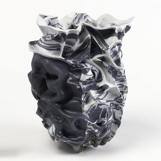 Folded and ridged abstract form of white, gray, and black clay with touches of red.