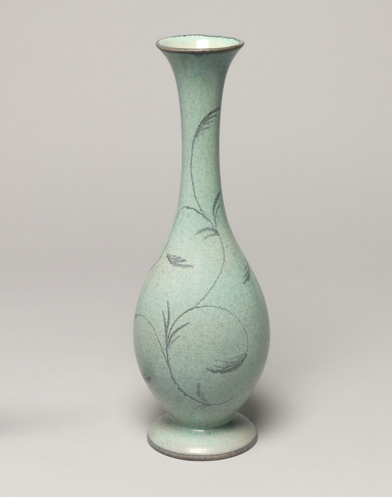 Ovoid vase with elongated neck and flared mouth with black rim; allover gray with thin black vines; foot also black rimmed.