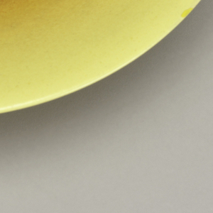 Flared yellow footed bowl.