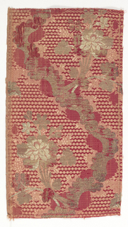 Silk brocade fragment in burgundy and cream showing a serpentine line of c-curves with floral bouquets. Buds brocaded in silver.