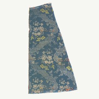 Silk fragments. Design shows trailing lace-like pattern and flower bouquets on a ground of blue chevron.