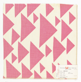 Sample of printed linen with small and large triangles, all facing one direction and randomly placed to form a pattern, in pink on a white ground.