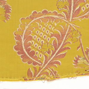 Yellow silk satin with brocaded design in violet, pink and silver, showing two parallel flowering vines with serpentine stems.