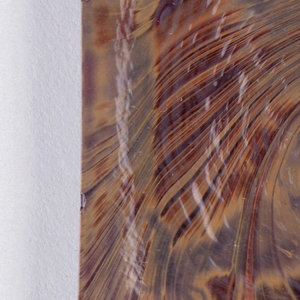 Square tile with brown to maroon marbleized design.