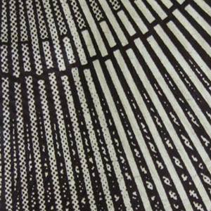 Circles with radiating lines. Printed in dark brown on an off-white ground, with glaze?