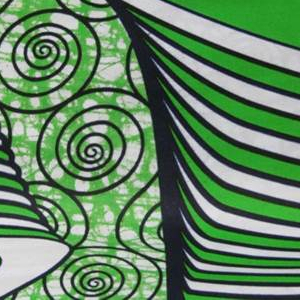 Striped drums on a background of arabesques. Printed in indigo, green and yellow on a white ground.