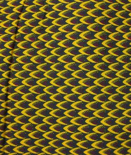 Overall pattern of small overlapping dart forms. Printed in indigo, yellow and red on a white ground.