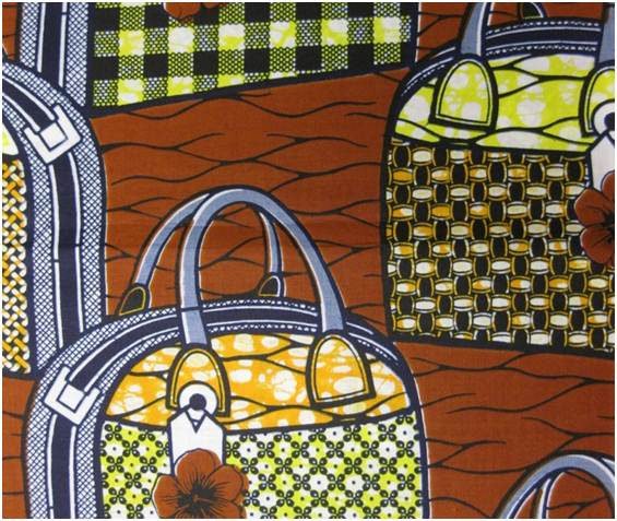 Purses of multiple patterns. Printed in indigo, yellow, orange and rust on a white ground.