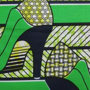 Women's high-heeled shoes. Printed in indigo, emerald green, lime green, and yellow on a white ground.