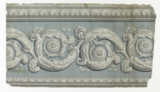 Wide acanthus rinceau at bottom of frieze, with narrow leaf and dart border at top, printed in grisaille on gray-green ground.