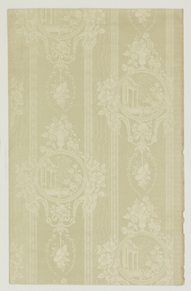 Medallion stripe design. Wide stripe with round medallion containing architectural fragment. This alternates vertically with foliate wreath containing women's hat. Next is a narrower band simulating moire. Entire surface is printed with a mica pigment in an off-white color.