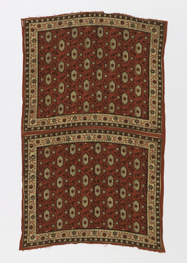 Rectangular panel with two uncut handkerchiefs printed on it. The field of each handkerchief has an overall pattern white hexagons filled with foliate elements in brown, with white borders with a red and brown flowering vine motif.