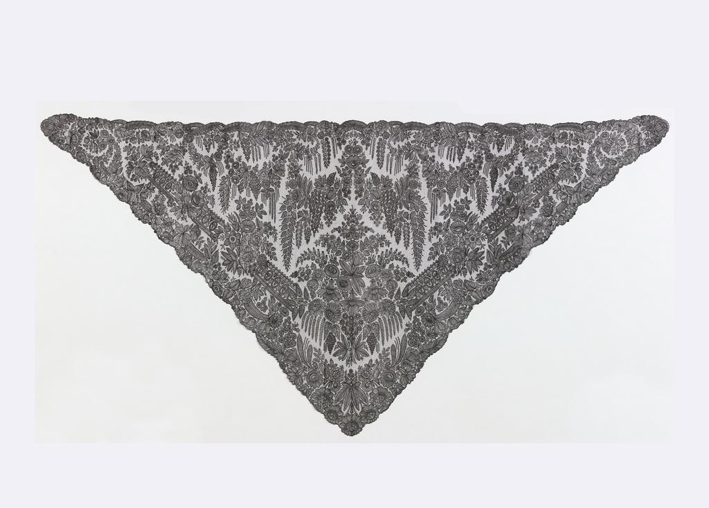 Triangular black silk Chantilly lace shawl with a floral design.