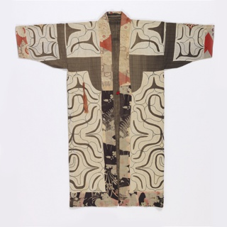 Long-sleeved robe with a foundation made from cotton with a small-scale woven check of brown, black and white. The dramatic design is made by cutting curved elements from white cotton fabric and stitching them to the plaid in the reverse appliqué technique. Fine yellow and light blue lines are added in buttonhole embroidery; the dark blue lines are couched cord. The centers of the radiating motifs use red and pink commercially printed fabrics, as do the neck band and hem edges.