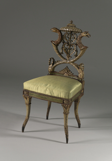 Elaborately carved and painted side chair. Back composed of crossed cornucopia, from which spring almost at right angles griffins and heads, holding between them an umbrella shaped canopy, with foliated stem of trumpet flowers, in false Chinese taste; surface is painted in buff, red, green, and blue. The rounded tapering legs curve inwards in the middle but splay out towards the feet; above the finely tapered feet, are carved acanthus leaves. Top of legs have square capitols carved with acanthus leaves and berries.