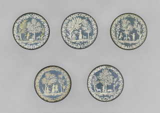 The cut paper (decoupage) is over a woven blue silk that creates a more minutely detailed but similar effect to the ivory and foil buttons of the period.  These depict a goatherd couple with love altar and celebrating under trees.