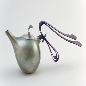 Silver-plated bulbous body tapering into elongated spout on one side; opposite spout, long handle composed of two curved, deep purple anodized aluminum elements overlapping and extending outward, joined by two green onyx beads at point of contact with each other. Circular lid with small square knop topped with curved, deep purple anodized aluminum tab handle.
