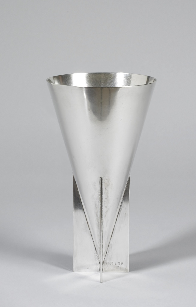 Inverted cone-shaped vase with base of cross form.