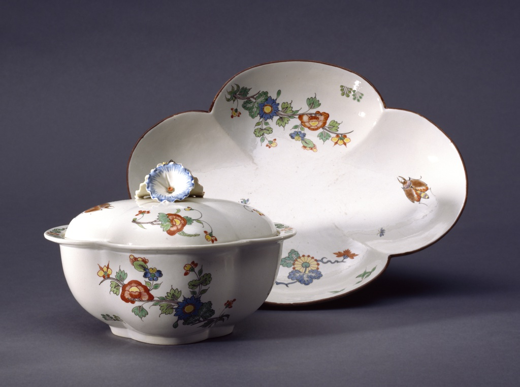 "Sauce boat with lid and tray.  Four-lobed, decorated with insects and branches of blossoms in the ""Korean"" style.  Rim of tray decorated with brown band. Cover with handle of three petunia-like flowers, and notched for ladle."