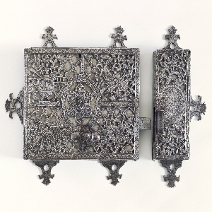 Solid and pierced plates cast and engraved with trophies and floral scrolls.
