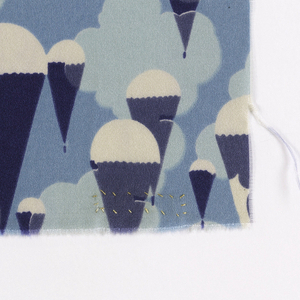 Printed dress silk with an abstracted design of parachutes descending parachutes against clouds, in several shades of blue on white.