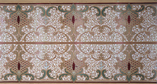 Scrolls and floral motifs on background of all-over mottled effect. Recommended for kitchens and children's rooms as the surface design hid fingermarks and dirt. Borders printed two across the width.