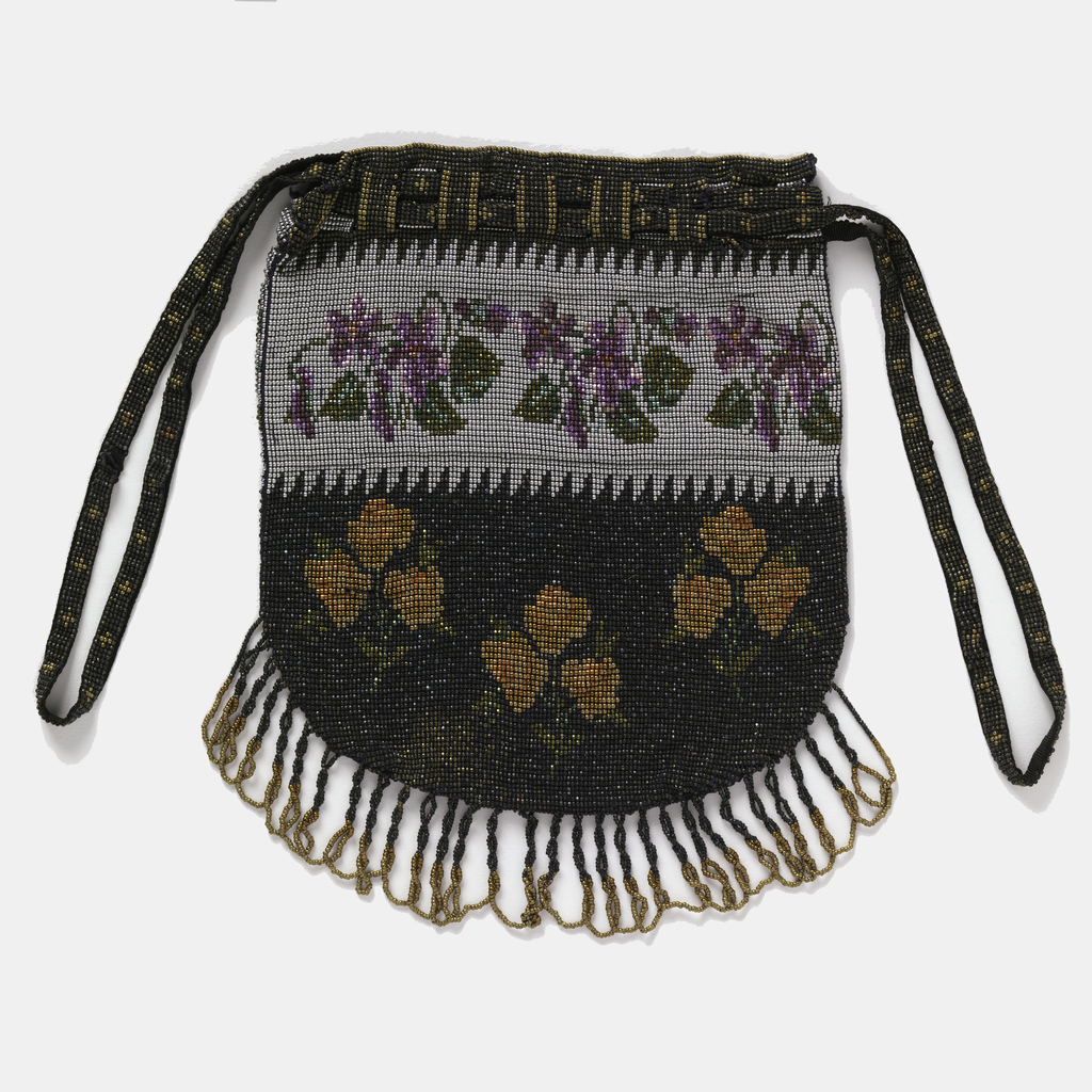 Rounded bag with drawstring top, fringed at bottom. Floral pattern of violets against a silver ground at top; orange roses against a black ground at bottom.