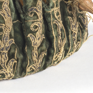 Embroidered gaming purse with drawstring; couched metal thread embroidery on green velvet. Lined with white leather.